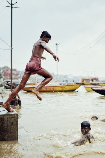 jump to Ganges India Sony Streetphotography Portrait Culture EyeEm Selects Water Full Length Real People Nature Jumping One Person Day Sea Outdoors Side View Swimming Lifestyles Motion Mid-air Sky Men