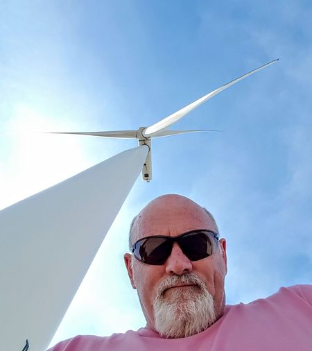 wind turbines Wind Turbine Wind Power Portrait Men Headshot Mature Men Front View Sunglasses Sky Windmill Industrial Windmill Environmental Conservation Fuel And Power Generation Renewable Energy Alternative Energy