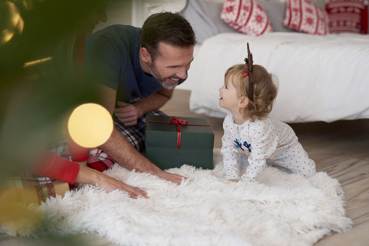 Man with daughter at home