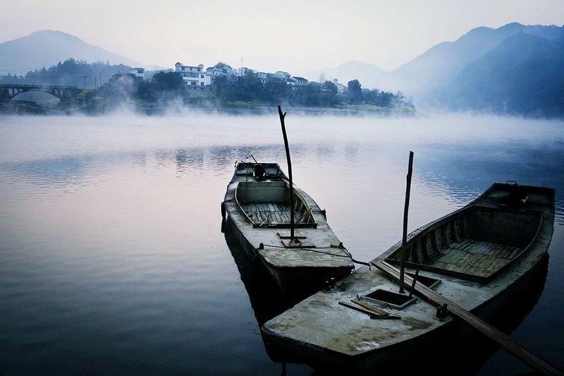 Boats On Lake In Fog