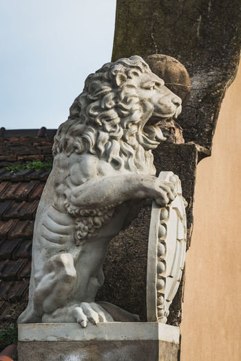 Statue against stone wall
