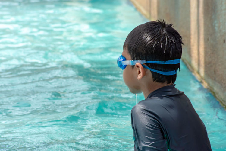 Asian boys are swimming in the pool. One Person Water Headshot Real People Men Leisure Activity Males  Lifestyles Pool Swimming Pool Portrait Child Swimming Boys Day Nature Swimming Goggles Childhood Eyewear Turquoise Colored Outdoors Adolescence  Teenage Boys