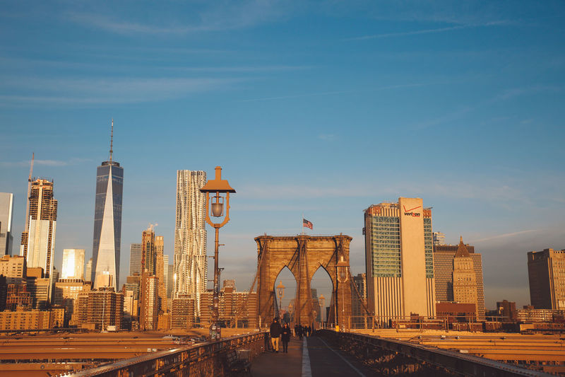 Brooklyn bridge and cityscape against sky