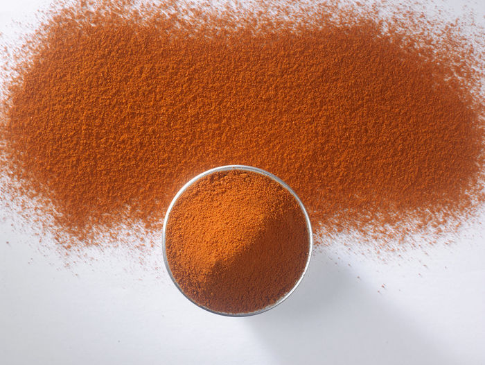 top view of ground chili Chili Pepper Curry Hot Red Spicy Aroma Blend Chili  Close-up Directly Above Flavor Food Food And Drink Grain Ground - Culinary Indoors  Ingredient No People Paprika Powder Preparation  Seasoning Spice Studio Shot White Background