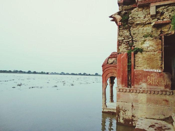 Banks of the river Yamuna 🕉️ Yamuna River Riverbank Riverside Spirituality Spiritual Hinduism Religion Religious  Religious Architecture Krishna Radhe Radhe Radhe Krishna Water Reflection Sky Architecture