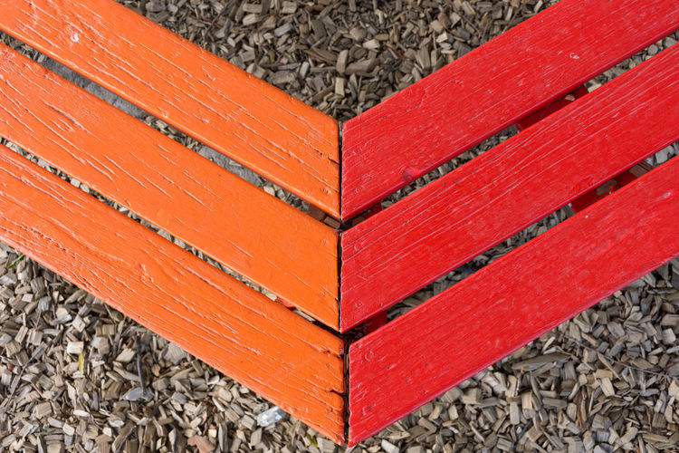 High angle view of red books on wood