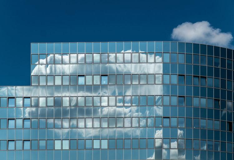 Glass modern building against sky