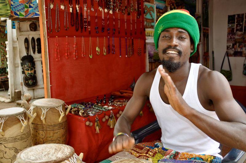 Drum Drummer Ghana Ghanaian Happy Having Fun Rastaman Adult Africa Art Market Cheerful Djembe Djembe Drum Looking At Camera Musician One Person Only Men Playing Playing Drums Portrait Rastafari Sitting Smiling Young Man Inner Power