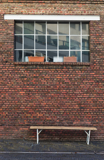 Emptiness Empty Chair Absence Architecture Bench Brick Brick Wall Building Building Exterior Built Structure City Day House Nature No People Outdoors Red Seat Wall Wall - Building Feature Window Wood - Material