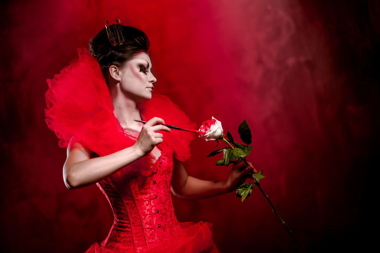 Young Woman Holding Rose