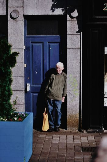 A Man with yellow bag CopyrightPiotrSzuber Galway Streetphotography Street Photography Streetphotography Colors Streetlife Picturing Individuality VSCO Vscocam M5