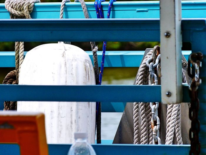 Ropes and buoy on boat