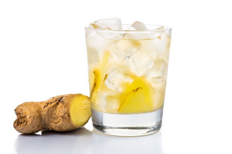 Cold icy refreshing and healthy ginger drinks Ginger Tea Tea Close-up Cold Temperature Cut Out Drink Drinking Glass Food Food And Drink Freshness Ginger Ice Cube Indoors  No People Refreshing Refreshment Still Life Studio Shot White Background