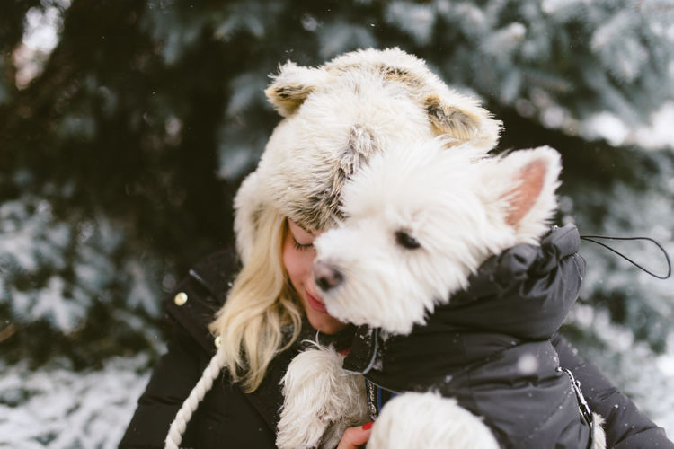 Christmas Winter Animal Animal Themes Canine Clothing Cold Temperature Day Dog Domestic Domestic Animals Focus On Foreground Mammal Nature One Animal One Person Outdoors Pet Owner Pets Real People Snow Snowing Vertebrate Warm Clothing Winter