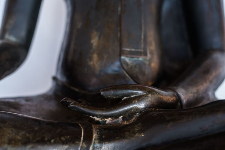 close up hand of black buddha statue Hand Black Black Buddha Tample Warship Religious  Thailand Art Close-up