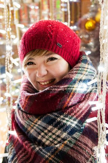 Winter Warm Clothing One Woman Only One Person Cold Temperature Only Women Scarf Portrait Looking At Camera Smiling Knit Hat Glove People Snow Front View Happiness Knitted  Christmas Christmas Decoration Christmas Lights Christmas Time Fair New Year's Eve Winter Russia
