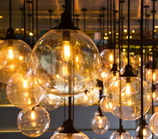 Close-up of illuminated lamp hanging at night