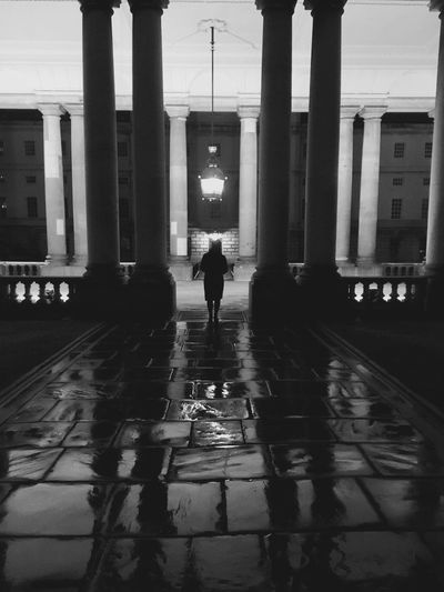 Shadows In History And Time Built Structure Walking Reflection Rear View Architectural Column Waiting Architecture Real People The Way Forward Full Length City