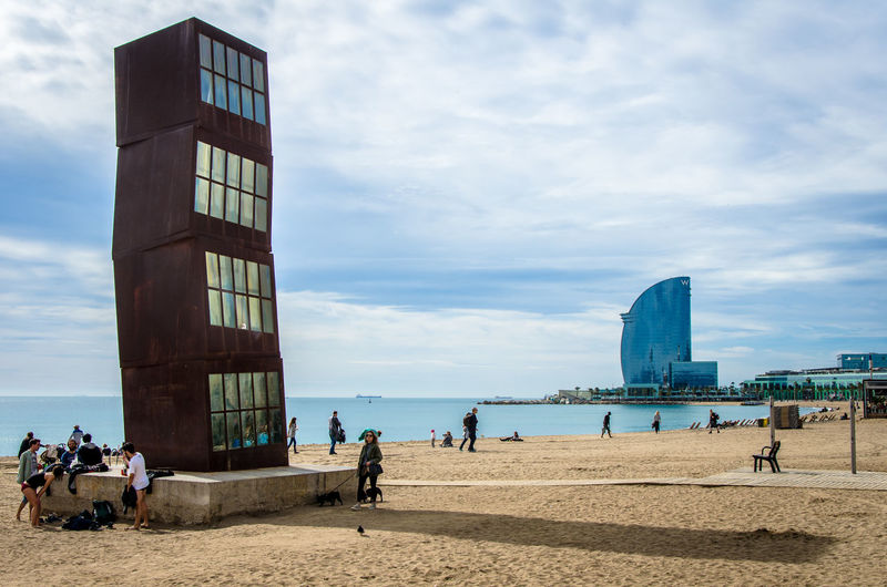 Architecture Barcelona Beach Building Exterior Built Structure City City Life Cloud Cloud - Sky Cloudy Large Group Of People Leisure Activity Lifestyles Men Modern Monument Person Playa Sea Shore Sky Summer Travel Traveling Water