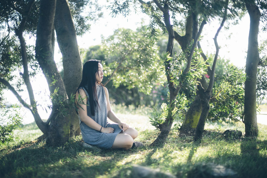 Beauty In Nature Casual Clothing Chill Chilling Day Forest Girl Grass Green Color Growth Leisure Activity Lifestyles Model Nature Outdoors Plant Portrait Portrait Of A Woman Portraits Relaxation Tranquil Scene Tranquility Tree Tree Trunk Wind