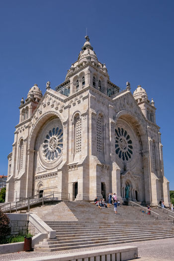 Facade of cathedral against clear blue sky