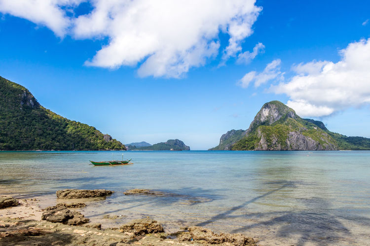 At El Nido, Palawan, Philippines Water Beauty In Nature Cloud - Sky Tranquil Scene Scenics - Nature Beach Outdoors Sea Tranquility Sky Idyllic Blue No People Nature Day Land Rock Mountain Non-urban Scene Solid Travel Travel Photography Philippines Elnido Elnidopalawan