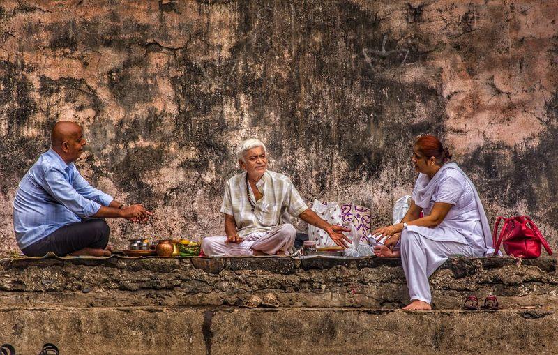Friends sitting on ground