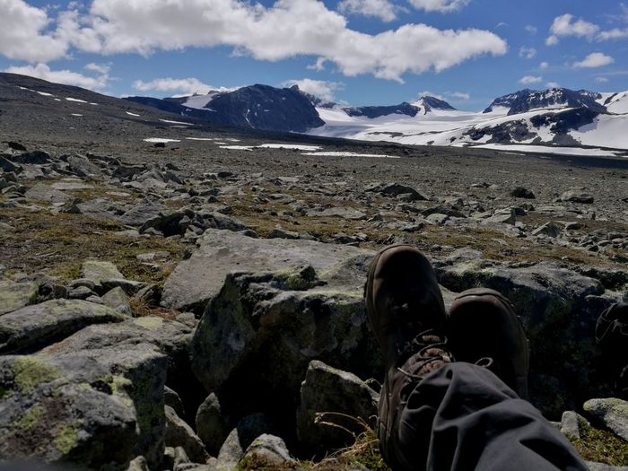 A quiet moment Cloud - Sky Shoe Personal Perspective Landscape Outdoors Great View Day Human Leg Nature Hiking Sky Adventure Beauty In Nature Smartphone Photographer Smartphonegraphy Huawei P9. Mobilephotography Mobile Photography Great Nature Jotunheimen Jotunheimen Nasjonalpark Jotunheimen National Park