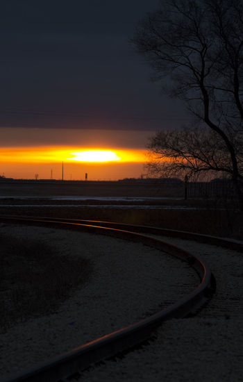 Sunset Rails Beauty In Nature Composition Dark EyeEm Best Shots Rails Sky Sun Sunset Tracks Train Tranquility Transportation Winnipeg The Great Outdoors - 2016 EyeEm Awards