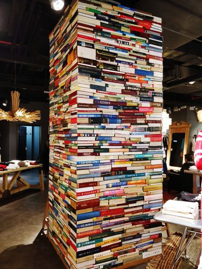 A pillar of books. Stack Business Finance And Industry Bookshelf Archives Book Shelf Hardcover Book Shelves Knowledge Bookstore Library Shop Display Stall Market Stall