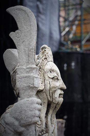 Ancient Chinese style stone sculpture in Wat Suthat Thepwanaram Bangkok, Thailand. Thailand Photos Wat Suthat Art And Craft Chinese Style Close-up Day Focus On Foreground Gargoyle Human Representation No People Outdoors Religion Sculpture Statue Stone Sculpture