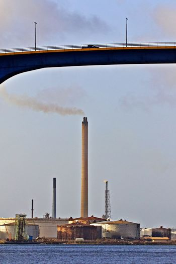 Built Structure Architecture Sky Building Exterior Water Industry Factory Smoke Stack No People Waterfront Outdoors Pollution Cloud - Sky Air Pollution Transportation Bridge Refinery