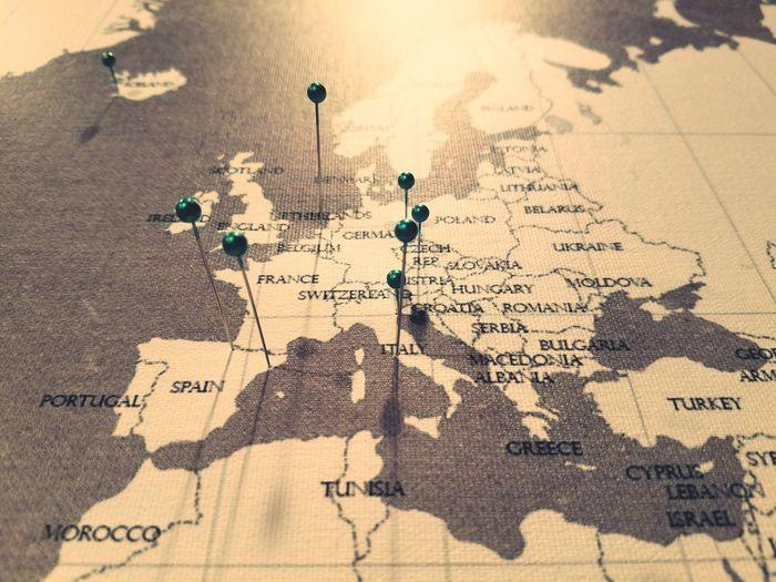 High angle view of thumbtacks on map