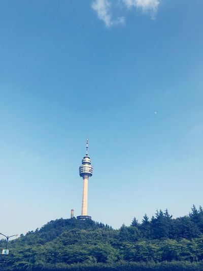 Low angle view of communication tower against sky