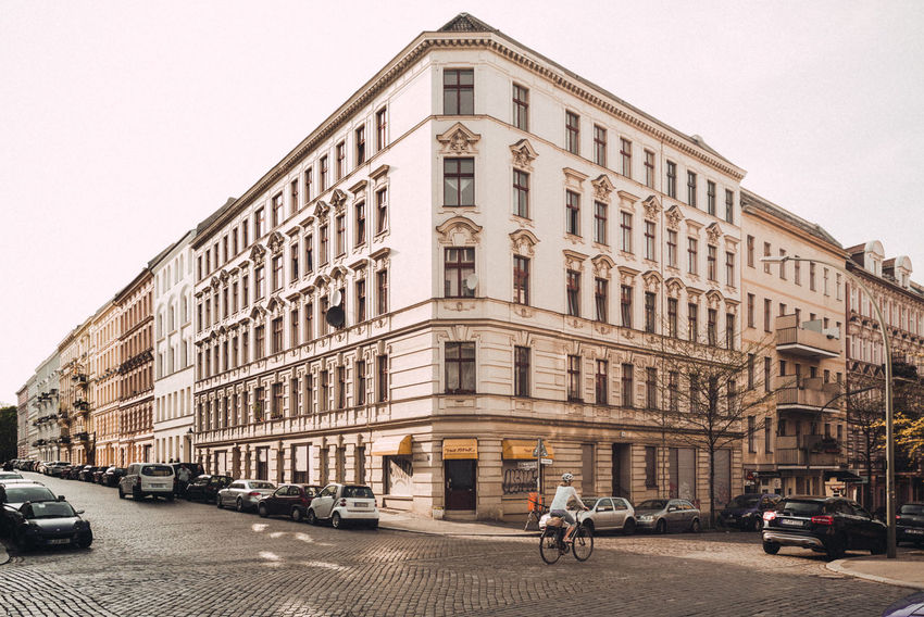 Residential district Kreuzberg City Life The Street Photographer - 2018 EyeEm Awards Urban Geometry Architecture Berliner Ansichten Building Building Exterior Built Structure Car City City Life Day Motor Vehicle Outdoors Real People Residential Building Residential District Residential Structure Road Sky Street Street Photography Streetphotography Transportation Urban