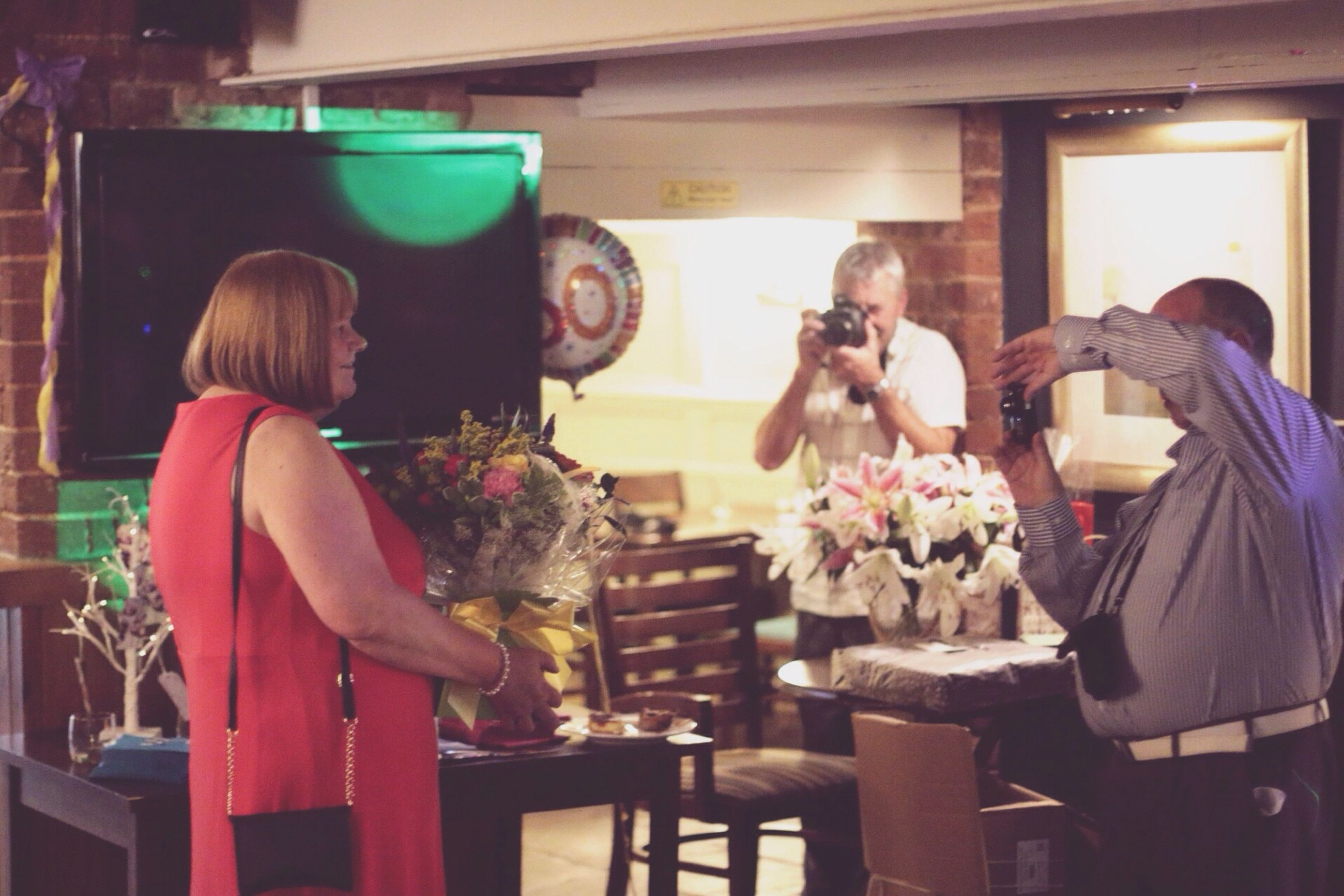 indoors, sitting, person, freshness, men, waist up, table, standing, bouquet, casual clothing, group of people, preparation, flower, restaurant, holding, bunch of flowers, looking, buying
