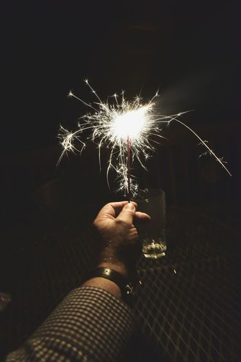 Hand holding sparkler at night Celebration Night Human Hand Human Body Part One Man Only One Person Only Men Firework - Man Made Object Exploding People Arts Culture And Entertainment Firework Display Illuminated Holding Sparkler Adult Adults Only Motion Men Bradley Olson Bradleywarren Photography Galena, Illinois Background Copy Space Outdoors