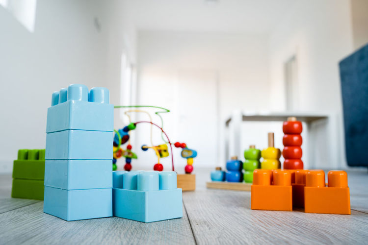 Multi Colored Indoors  Toy Home Interior Focus On Foreground No People Toy Block Still Life Leisure Activity Table Close-up Wood - Material Plastic Domestic Room Selective Focus Large Group Of Objects Blue Order Lifestyles