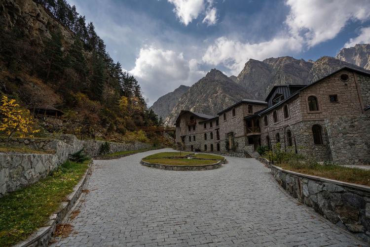 Road amidst buildings against sky