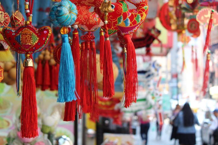 Close-up of souvenirs hanging at market stall