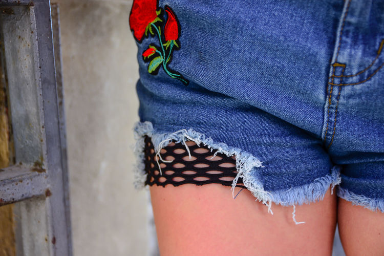 Adult Body Part Casual Clothing Close-up Clothing Day Fashion Focus On Foreground Human Body Part Human Leg Human Limb Jeans Leisure Activity Lifestyles Midsection Multi Colored One Person Real People Scarf Textile Wall - Building Feature Women