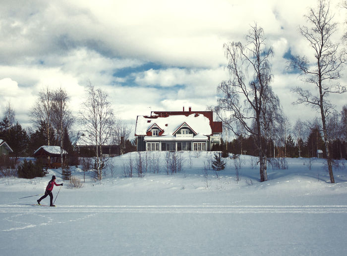 Skiing EyeEm Best Shots Architecture Bare Tree Building Building Exterior Built Structure Cloud - Sky Cold Temperature Day Full Length House Nature One Person Outdoors Plant Real People Sky Snow Sport Tree Warm Clothing Winter Frozen