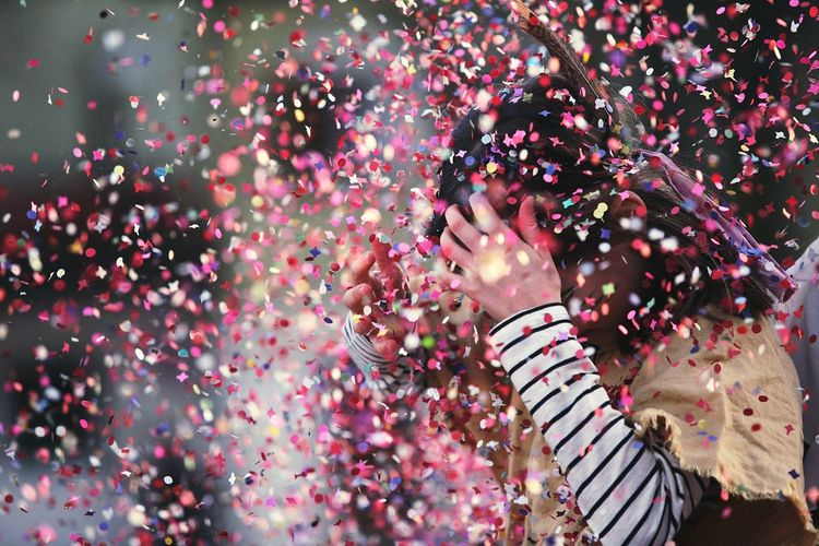 Close-Up Of Girl Covered In Confetti