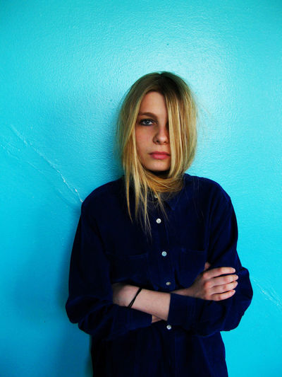 Young Adult Blond Hair Hair Blue Background Wall - Building Feature Hairstyle Long Hair Young Women Blue Emotion Looking At Camera Portrait Casual Clothing Sadness Indoors  Women Portrait Of A Woman Sad Girl Girls Thoughtful Face One Person Depression - Sadness Hair