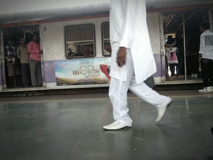 Man in White Half Body White Clothes White Shoes Candid Photography Mobilephotography Adults Only One Person People Human Leg Railway Station Platform White Clothing Human Foot Moving Passenger Train Metro Train Train - Vehicle Rail Transportation Train
