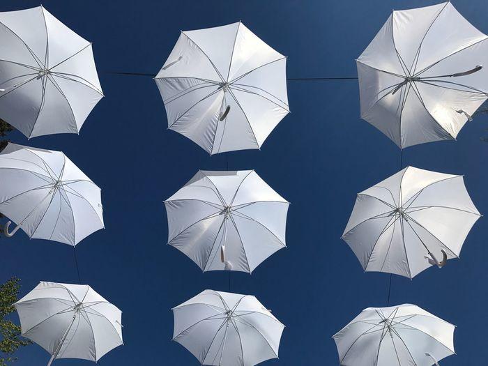 Umbrellas against clear sky