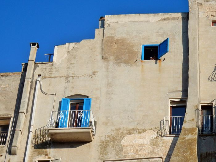 Window Building Exterior Architecture Built Structure Low Angle View Building Blue Day Residential District Sunlight Sky Nature Outdoors Old Clear Sky Shadow House Wall - Building Feature Balcony Alley Location Apartment Cellular Phone Cala Monachile Turista