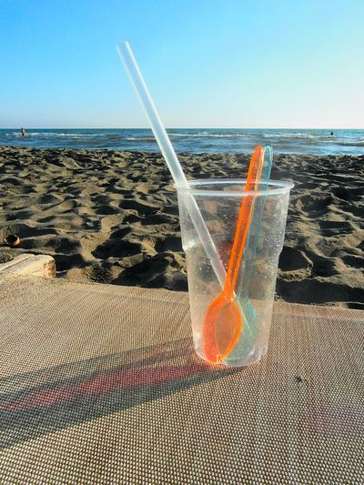 Beach Sea Sand Horizon Over Water Water Outdoors Day No People Sky Wave Nature Plastic Glass Shadow Composition Colored Shadow Drinking Glass Seaside On The Horizon