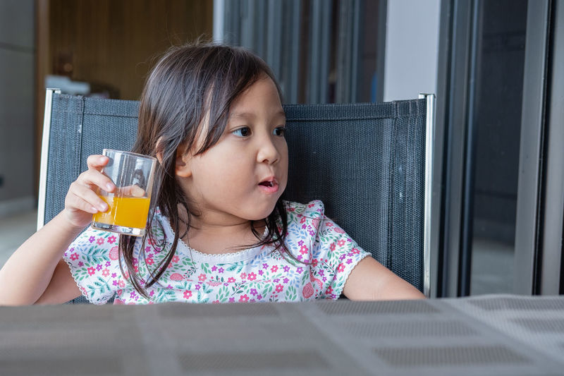 Close-Up Of Girl Drinking Juice