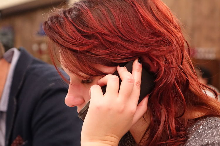 Close-up of young woman talking on mobile phone